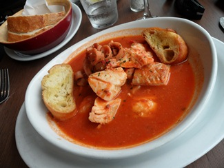 Cioppino, seafood soup with cod, salmon, calamari, shrimp in light spicy sauce.