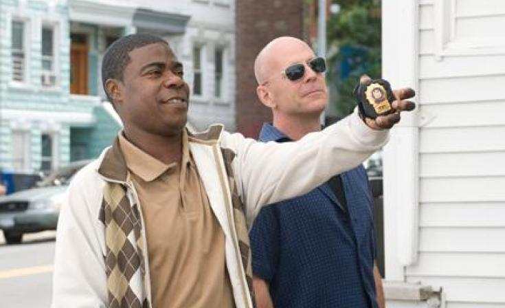 "(L-R) Tracy Morgan as Paul and Bruce Willis as Jimmy in ""Cop Out."""