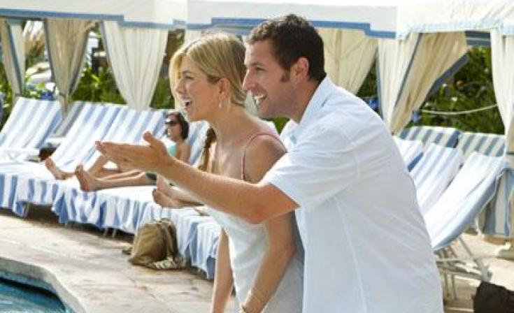 "Jennifer Aniston as Katherine and Adam Sandler as Danny in ""Just Go With It."""