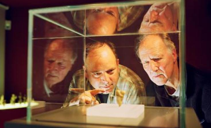 "(L-R) Nicholas Conard and Werner Herzog in ""Cave of Forgotten Dreams."""