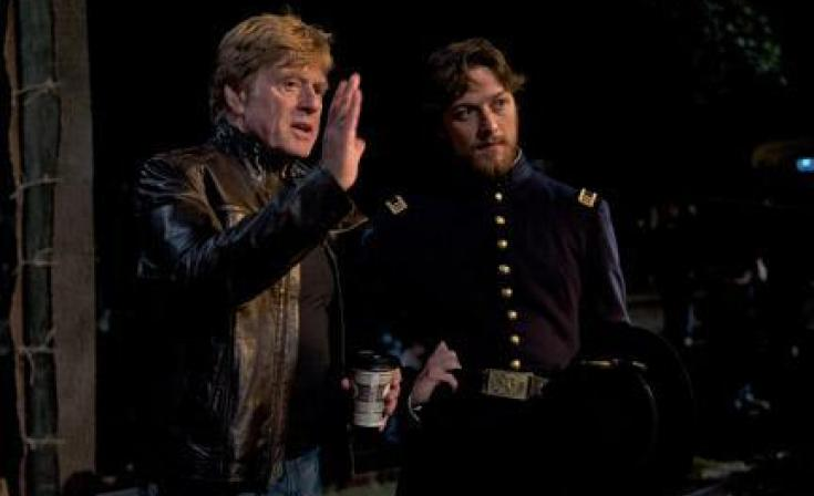 "(L-R) Robert Redford and James McAvoy on the set of ""The Conspirator."""