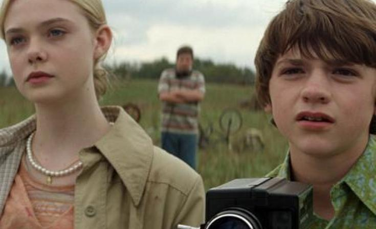 "Elle Fanning as Alice Dainard and Joel Courtney as Joe Lamb in ""Super 8."""