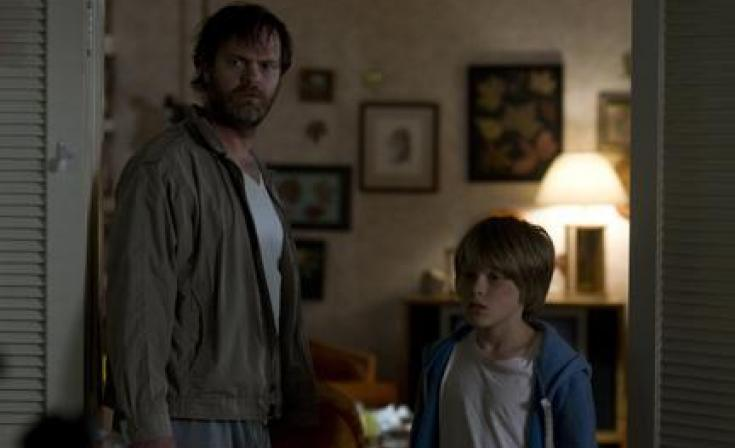 "(L-R) Rainn Wilson as Paul Forney and Devin Brochu as T.J. in ""Hesher."""