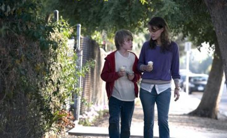 "Devin Brochu as T.J. and Natalie Portman as Nicole in ""Hesher."""