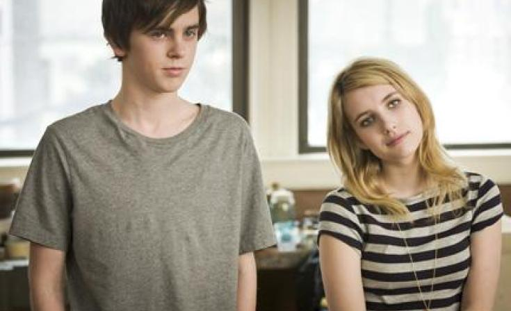 """Freddie Highmore as George and Emma Roberts as Sally in """"The Art of Getting By."""""""